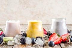 Summer fruits and berries smoothie. Drink. Vitamin diet snack beverage, with blueberries, strawberries, blackberries, kiwi. Dark blue concrete background copy royalty free stock images