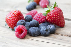 Summer fruits and berries, strawberries, blueberries, raspberrie. Natural shot on old wooden background of summer berries Stock Photo