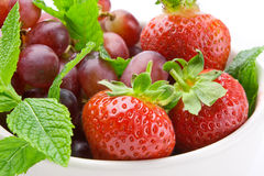 Summer fruits in a bowl with mint royalty free stock photo