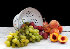 Summer fruits with ceramic colander Stock Photography