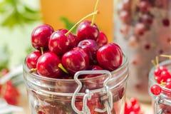 Summer fruits closeup cherries jar processed Stock Photos