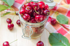 Summer fruits closeup cherries jar processed Royalty Free Stock Photo