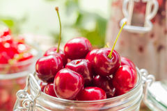 Summer fruits closeup cherries jar processed Royalty Free Stock Photos