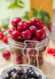 Summer fruits closeup cherries jar processed Stock Photography