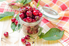 Summer fruits closeup cherries jar processed Royalty Free Stock Images