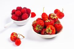Summer fruits concept strawberry and rasberry in ceramic cup on. White background with copy space Stock Image