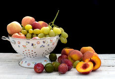 Summer fruits inside ceramic colander Stock Photography