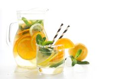 Summer fruits lemonade with ice and mint on white. Close up. royalty free stock photography