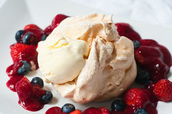 Summer fruits pavlova and ice cream Stock Photography