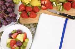 Summer fruits salad selection, recipe book, cookbook, copy space. Summer fruit salad, cookbook, copy space Royalty Free Stock Photography