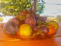 Summer fruits variety against a beautiful background. Royalty Free Stock Photo