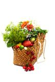Summer fruits, vegetables and flowers in a basket Stock Images