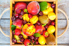 Summer fruits in a wooden box stock photography