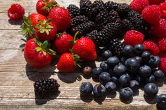 Summer Fruits on a wooden table in a garden. Royalty Free Stock Photos