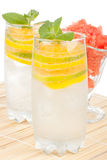 Summer fruity drink with ice Royalty Free Stock Images