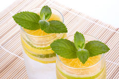 Summer fruity drink with ice Stock Images