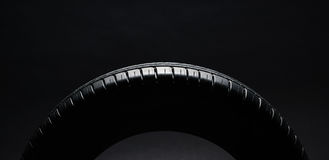 Summer fuel efficient car tires on black background Royalty Free Stock Photo