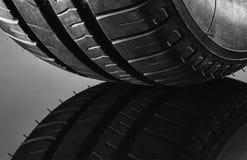 Summer fuel efficient car tires on black background stock images