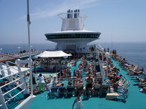 Summer Fun. Overshot of cruise go-ers taking in the sun on the pool deck on a cruise Royalty Free Stock Photo