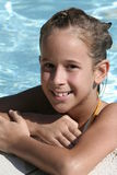 Summer fun. A young girl enjoys a day in the pool Royalty Free Stock Image