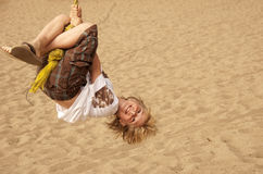 Summer Fun. A boy having fun swinging on a rope at a park Stock Images