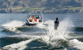 Summer fun. Water skiier seen from behind Stock Image