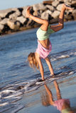 Summer fun. Little girl playing by the ocean Stock Photo