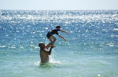 Summer Fun. Father and Son having fun in the water at Port Rickaby, South Australia Royalty Free Stock Photo