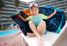 Summer fun. Little Girl near the pool covering on beach towel Stock Images