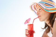 Summer fun. Woman drinking cocktail Royalty Free Stock Images