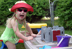 Summer Fun. Young toddler in swimsuit having fun playing with summer toys Stock Images