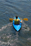 Summer is fun. Teen kayaking on river royalty free stock images