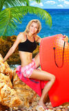 Summer fun on the beach. Beautiful sporty female holding body board, outdoor beach portrait, water sport, healthy lifestyle concept Stock Images