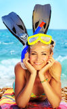 Summer fun on the beach. Beautiful female closeup portrait on the beach wearing snorkeling equipment, water sport, healthy lifestyle concept Royalty Free Stock Photo
