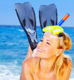 Summer fun on the beach. Beautiful female closeup portrait on the beach wearing snorkeling equipment, water sport, healthy lifestyle concept Stock Photo