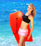 Summer fun on the beach. Beautiful sporty female holding body board, outdoor beach portrait, water sport, healthy lifestyle concept Stock Image