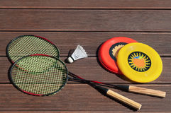 Summer fun, frisbee, badminton racquets, playing outside Royalty Free Stock Photos