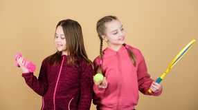 Summer fun. Happy children with sport equipment. Sport success. Little girl. Fitness barbell. gym workout of teen girls. Tennis racket and ball for activity. I stock photography
