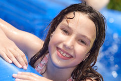 Summer fun. Happy girl in inflatable pool stock image