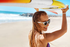Summer Fun, Holidays Travel Vacation. Surfing. Girl With Surfboard Stock Photo