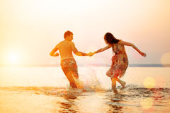Summer fun holyday on beach background. Couple in love in beach Stock Images