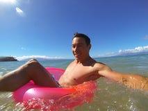 Summer Fun. Man enjoying the water and beach Stock Photography