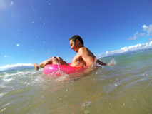 Summer Fun. Man enjoying the water and beach Royalty Free Stock Photos