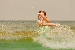 Redhead woman playing in water during summertime royalty free stock photos