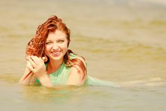 Redhead woman posing in water during summertime royalty free stock photo