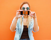Summer, fun, technology and people concept - cool girl makes sel Stock Image