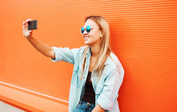Summer, fun, technology and people concept - cool hipster girl Stock Photos
