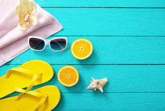 Summer fun time and accessories on blue wooden background. Mock up. Oranges Stock Images