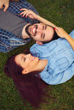 Summer fun. Top view of a young couple in love lying together Stock Image