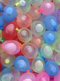 Summer fun. Water balloons rainbow colors summer fun royalty free stock images